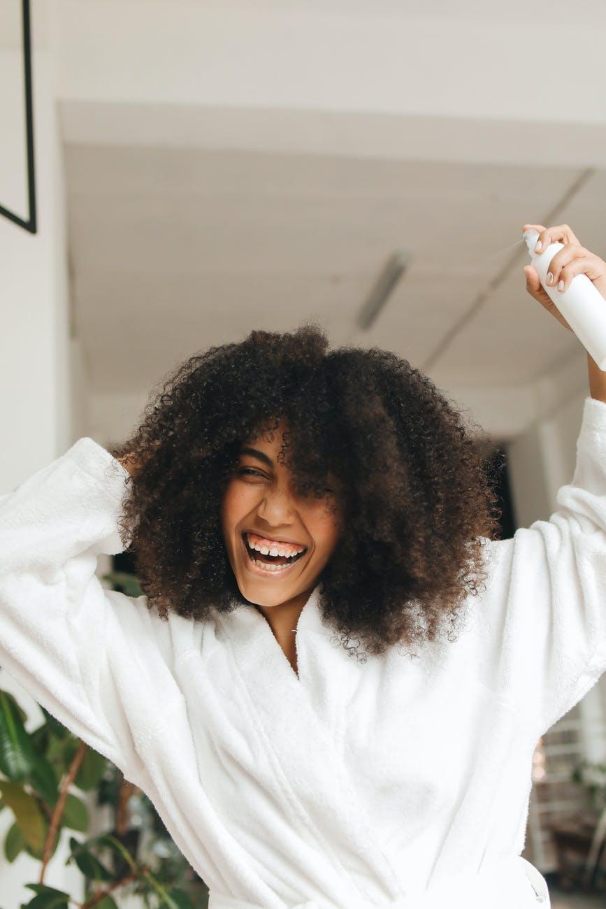 woman holding a hair spray
